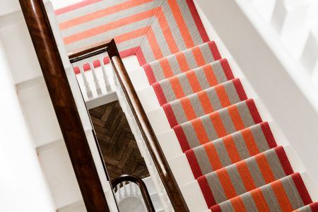 Bespoke carpeted handmade staircase by Hawker Joinery